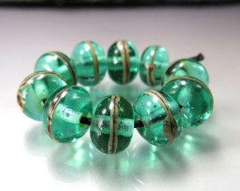 Handmade Lampwork  Beads by GlassBeadArt ...  Silvered Ivory over transparent green   ... SRA F12 ...9x11mm