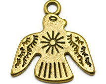 8 Thunderbird Charms gold tone metal (S475)