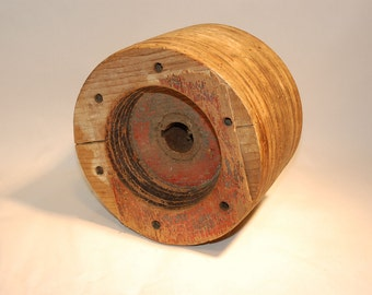 vintage wooden wheel with rusty iron center 10 inch diameter x 6 1/2 inches wide1 1/2 inch hole