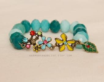 Flower bracelet, flower charm jewelry, flower jewelry, ladybug charm, blue bead bracelet, gift for gardener, gift for mom, gift for grandma,