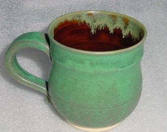 Green and Amber Wheel Thrown Pottery Mug or Cup with Chattered Matte Green Outside and Amber Inside