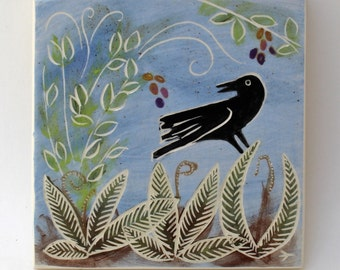 crow in springtime hand carved ceramic art tile