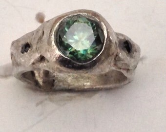 Greenish blue Mossanite stone in silver ring