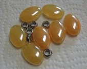 Butterscotch Oval Acrylic Beads and Silver tone Acrylic Beads