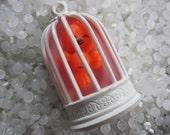 Vibtage Avon pin brooch orange bird in a white birdcage.