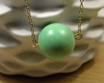 Green, chalk turquoise, pendant necklace on a brass chain