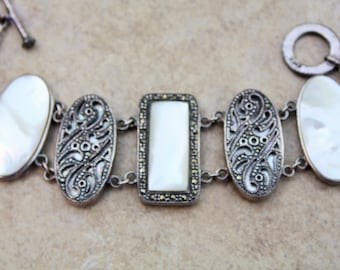 Vintage, marked Sterling Silver Marcasite and Mother of Pearl Bracelet. Wt 47.9. Length 7.5""