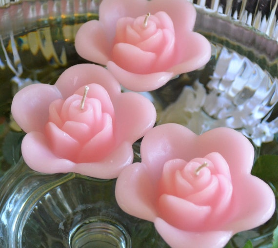 12 LIght pink floating rose wedding candles for table centerpiece and reception decor.