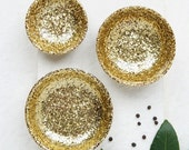 Trio set of three.One large,one medium and one small resin salt and pepper spice pinch trinket dish bowls in gold glitter.