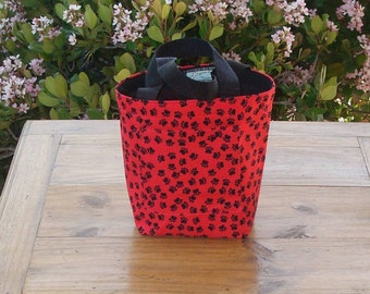 Dog Accessory Tote in a Black Pawprint on Red Print