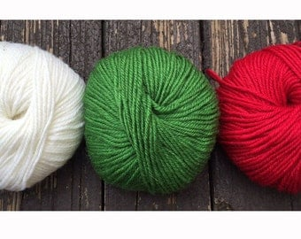 300 yards worsted weight yarn, white, green and red, 5.2 oz. 150 grams  Christmas knitting