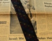 How about a Skinny Tie for Dad this Christmas ? 1960's with Multi Colored Crowns on Iridescent  fabric.