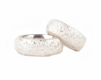 "wedding rings with a small ""bubble structure"" on the surface"