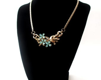 Unsigned Gold tone Metal Blue Rhinestone Flower & Clear Baguette Rhinestone Focal Floral Choker Necklace