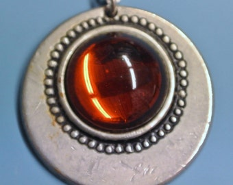 Signed vintage 1960s swedish handcrafted round pewter pendant necklace with golden brown round centerpiece