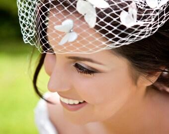Ivory Blusher Birdcage veil with silk butterfly detail and Swarovski crystal. Wedding, Bride, UK.