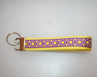 Yellow webbing with purple and yellow polka dots key chain fob wristlet