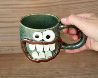 Funny Beer Mug. 12 Ounce Man Mug. Green Coffee Cup. Ceramic Stoneware Pottery Tankard. Funny Smiley Face Soup Mug for Guys. LEFT-HANDED.