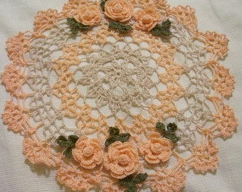 peach and ecru crocheted doily