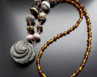 Swirl Necklace with unique, handmade ceramic focal in granite and artisan, crafted beads with vintage glass beads. Stunning, rustic necklace