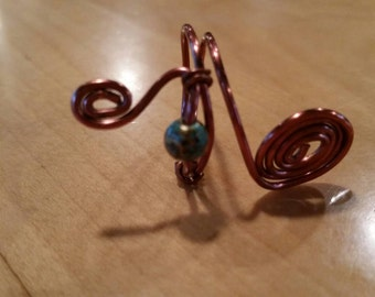 Curvaceous copper wire ring.