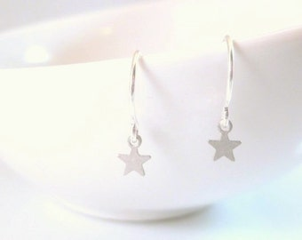 Tiny silver star earrings - micro mini matte silver minimalist charm dangles on small delicate silver plated ear hooks - simple little star