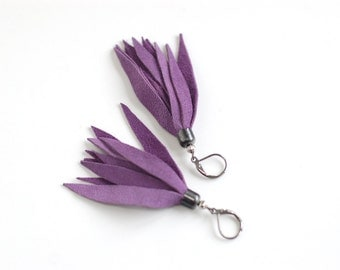Suede leather tassel earrings in bright violet