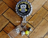Black...yellow...grey...owl....Retractable Badge Reel