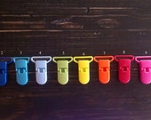 25 plastics clips / pacifier Holders