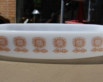 Vintage Fireking casserole or baking dish in cool retro brown flower pattern. 1 1/2 quart.