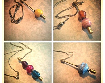 Interchangeable bead and charm pendant