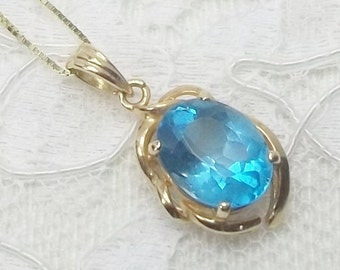 Vintage 14K Yellow Gold and 2.75 Carat Blue Topaz Pendant with 18 Inch Yellow Gold Box Chain