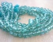 Caribbean blue apatite smooth polished rounds 3.5-4mm 1/2 strand