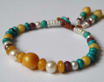 Gemstone bracelet - Baltic Amber - Ruby - Turquoise - Freshwater Pearls - rust colored cord - macrame loop closing - tassel - Tribal