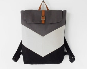 Black and gray canvas, chevron backpack / Laptop bag / diaper bag / travel bag.  7 inside pockets. Waterproof poly lining available
