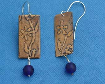 Roller Printed Flower Bronze and Sterling Silver Earrings with Blue Glass Bead