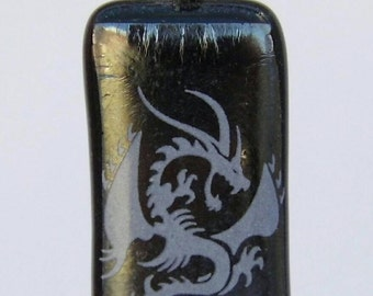 white dragon on special black glass pendant.