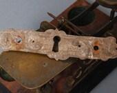 Antique metal key hole escutcheon. Art Nouveau