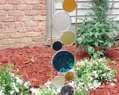 Stained glass garden art stake dark aqua chartreuse amber purple teal green outdoor modern garden sculpture