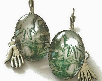 Sale was 17uk now 12uk ,150 years of Alice in Wonderland..Glove and Hand White Rabbit leverback earrings.