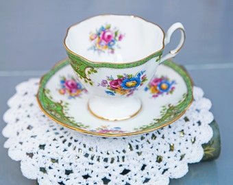 Green and White Floral Tea Cup and Saucer