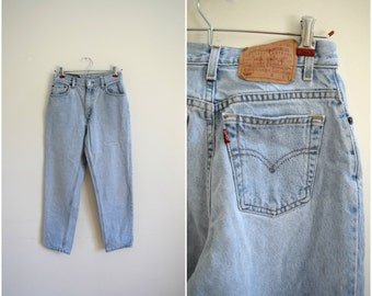 Vintage Levis light wash straight leg jeans / women's high waisted tapered leg jeans / size 6 pants