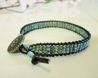 Handmade, Designed by Banblesbaubles, Leather stacking bracelet,  Picasso Czech 8/0 Seed beads, round brass button, BOHO