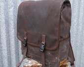 The mini, dark brown small waxed canvas backpack