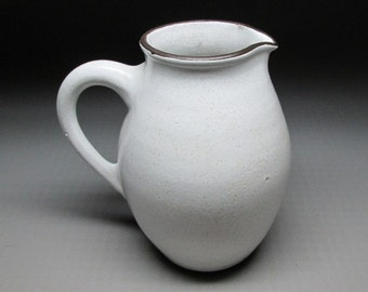 pottery pitcher ZAALBERG HOLLAND white glaze on a very dark clay