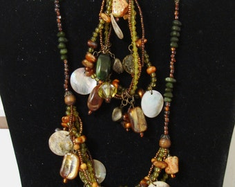 glass bead  NECKLACE is 15 to 18 inch. Matching BRACELET is 7- 8 inch   colors are darkish greens & oranges with abalone shells