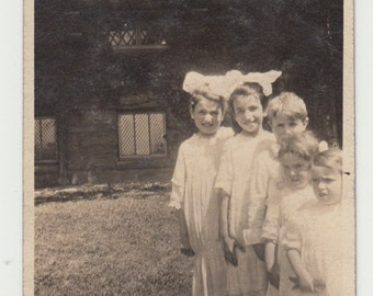Vintage/Antique photo of adorable children standing from the smallest to the tallest