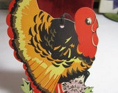 Vintage 1920's-30's die cut and gold gilded Gibson thanksgiving themed bridge tally turkey in garden