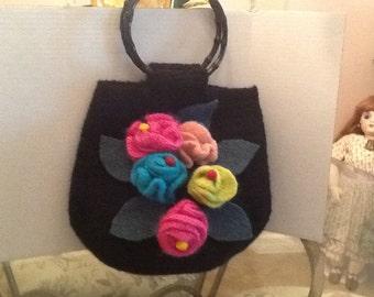 Hand knit felted floral bag.