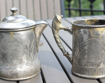 Old silver and creamer